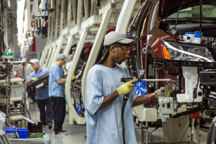 Workers assemble Volkswagen Passat sedans at the German automaker's plant in Chattanooga, Tenn., on June 12, 2013. The automaker announced a new policy Wednesday that would allow interaction with labor unions at the plant.