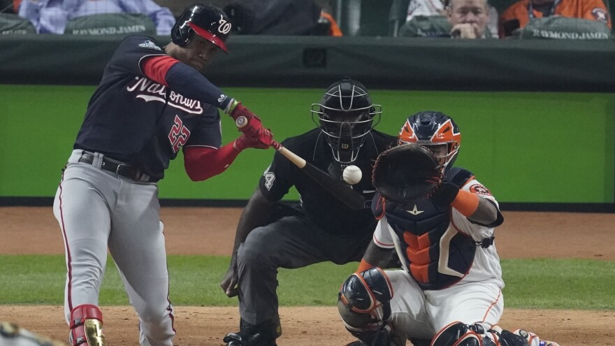 Washington Nationals' Juan Soto blasts a home run during the fourth inning of Game 1 of the World Series against the Houston Astros on Tuesday.