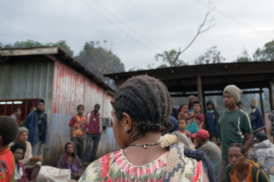 A woman sells betel nut at a market in Goroka, Papua New Guinea.