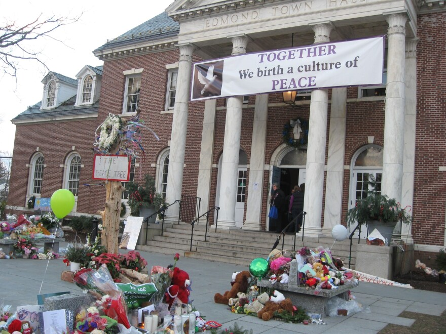 In Newtown, Conn., makeshift memorials have been set up outside the town hall, which is holding thousands of toys and stuffed animals for residents as the holidays approach.