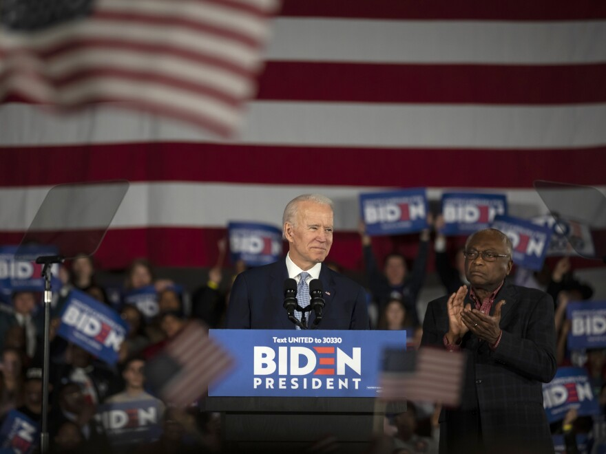 Joe Biden celebrates his win in the South Carolina primary on Feb. 29, 2020. An endorsement from Rep. James Clyburn (right) proved pivotal.