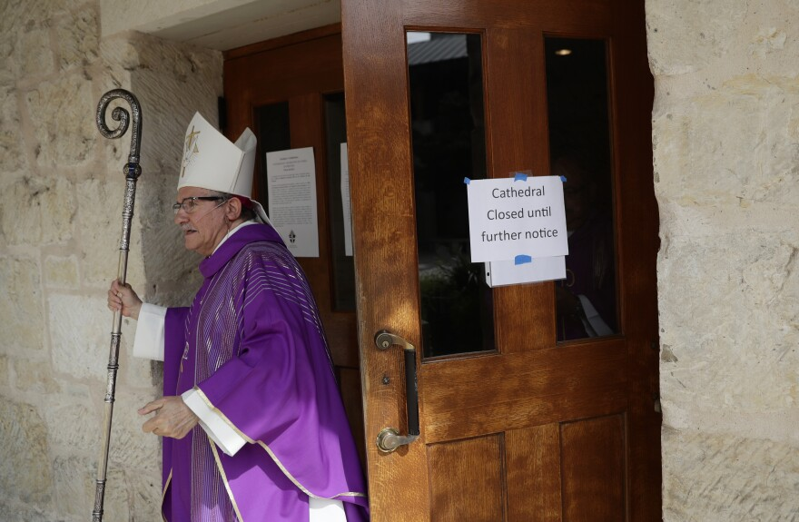 Bishop Michael Boulette exits San Fernando Cathedral after leading a televised service to an empty church in San Antonio, Texas on March 29. Due to the coronavirus outbreak churches in the area are closed and many are televising services or holding services online.