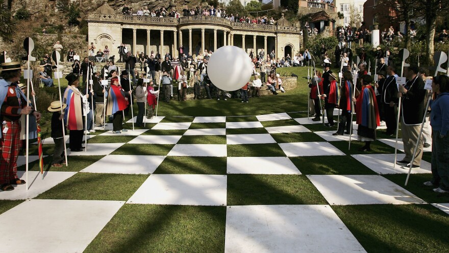 "In 2007, members of ""SixofOne"" — a fan club of the television series <em>The Prisoner</em> — re-enacted the game of human chess from the episode ""Checkmate,"" while the sinister Rover (center) looked on."
