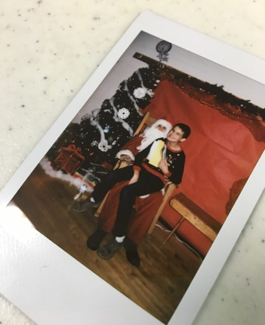 This is only the second picture Ryan's Mom has managed to get with Santa.