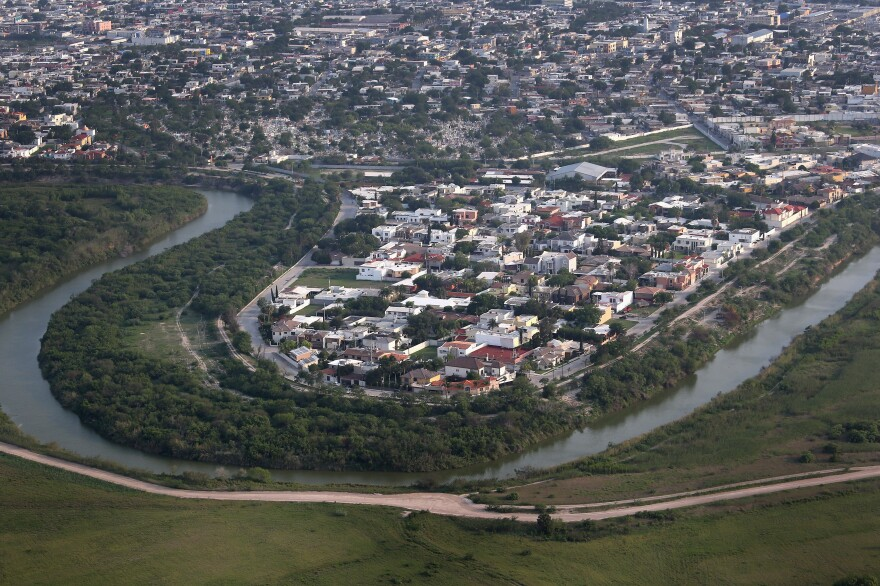 The Mexican border town of Matamoros is seen on the Rio Grande across the U.S.-Mexico border on May 21, 2013, near Brownsville, Texas. The area is active for smugglers bringing their product north from Mexico into the United States.