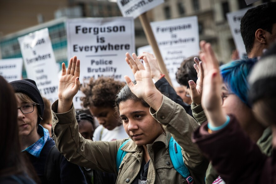 People rally in Union Square before marching through the street in protest to the Ferguson grand jury decision to not indict officer Darren Wilson in the Michael Brown case.
