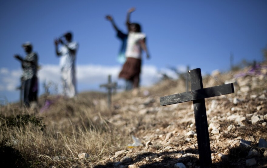 Relatives of those who died in the 2010 earthquake attend a memorial service at the mass grave site in Titanyen, on the outskirts of Port-au-Prince, Haiti, Thursday. Haitians are marking the second anniversary of the devastating 2010 earthquake with church services throughout the country on what is a national holiday of remembrance.