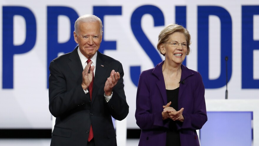 Joe Biden and Elizabeth Warren stand together prior to a Democratic presidential primary debate in October.