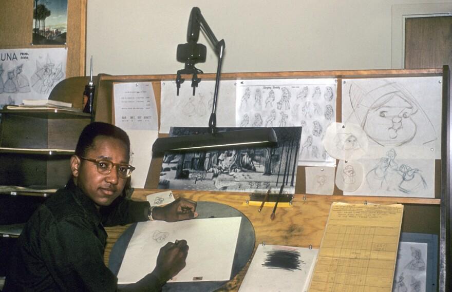 "Floyd Norman was Disney's first African-American animator. He's shown above in 1956, working as an ""apprentice inbetweener"" on <em>Sleeping Beauty.</em>"