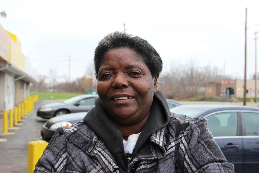 Jennice Badon outside the South End Market in Flint, Mich. She moved to Flint with her parents from Mississippi when she was 6 years old.