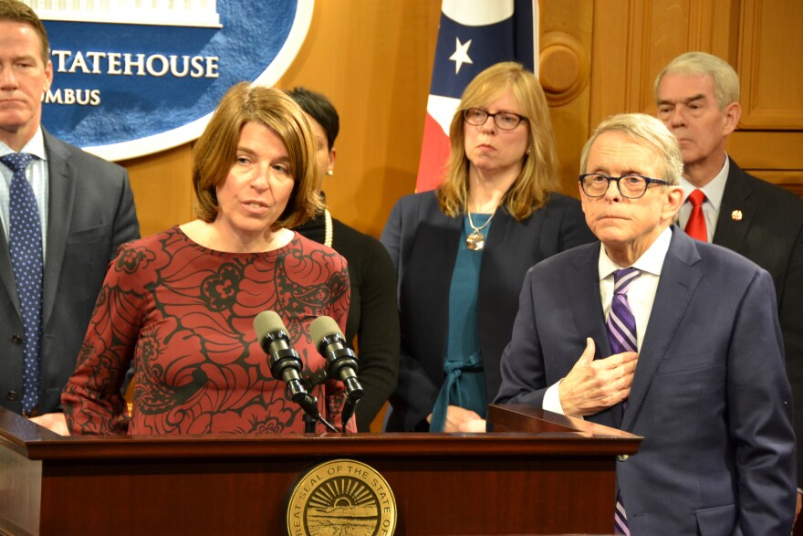 Ohio Department of Mental Health and Drug Addiction Services Director Lori Criss, speaking about her selection by Gov. Mike DeWine (right) to lead that agency in January 2019.