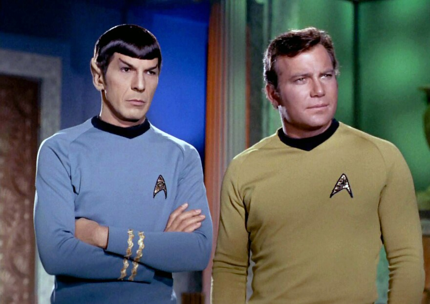 While Leonard Nimoy became famous as <em>Star Trek</em>'s Mr. Spock, he was conflicted about the role. He later came to embrace it. He's shown here with actor William Shatner as Captain James T. Kirk.