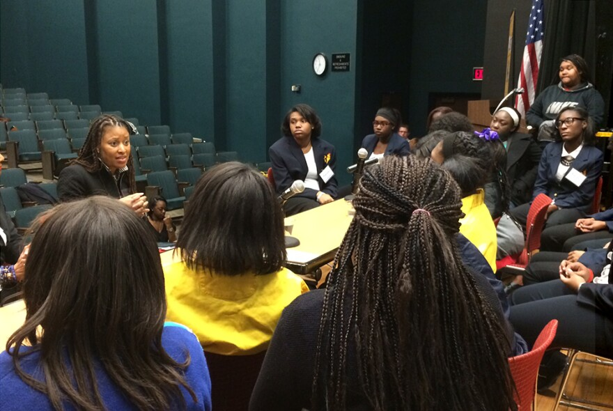 National Urban League Young Professional President Brandi Richard encourages a group of teenage girls to be supportive in their comments to each other.