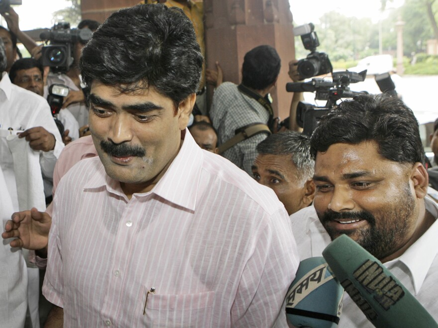 Indian lawmakers Mohammed Shahabuddin (left) and Pappu Yadav were both serving jail sentences when they arrived at India's Parliament for a vote in 2008.