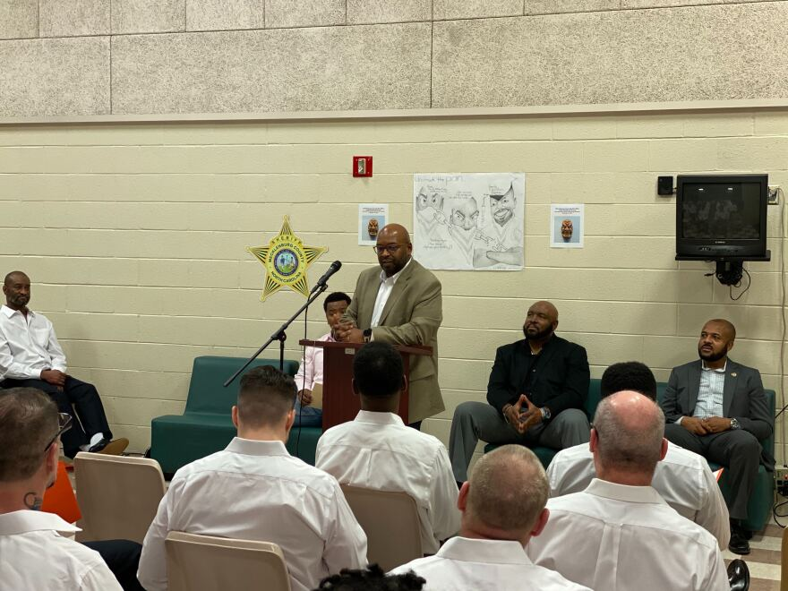 Former MCDC inmate Ellis Royster speaks to the group about personal trauma and fatherhood.