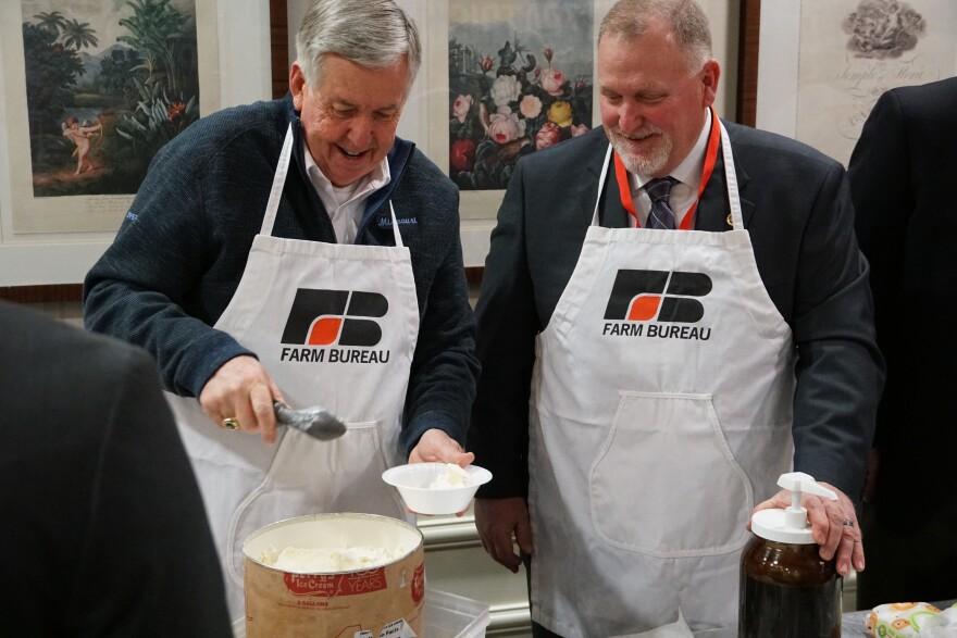 Gov. Mike Parson scoops ice cream beside Senate President Pro Tem Dave Schatz, R-Sullivan, on March 2, 2019, at Lincoln Days.