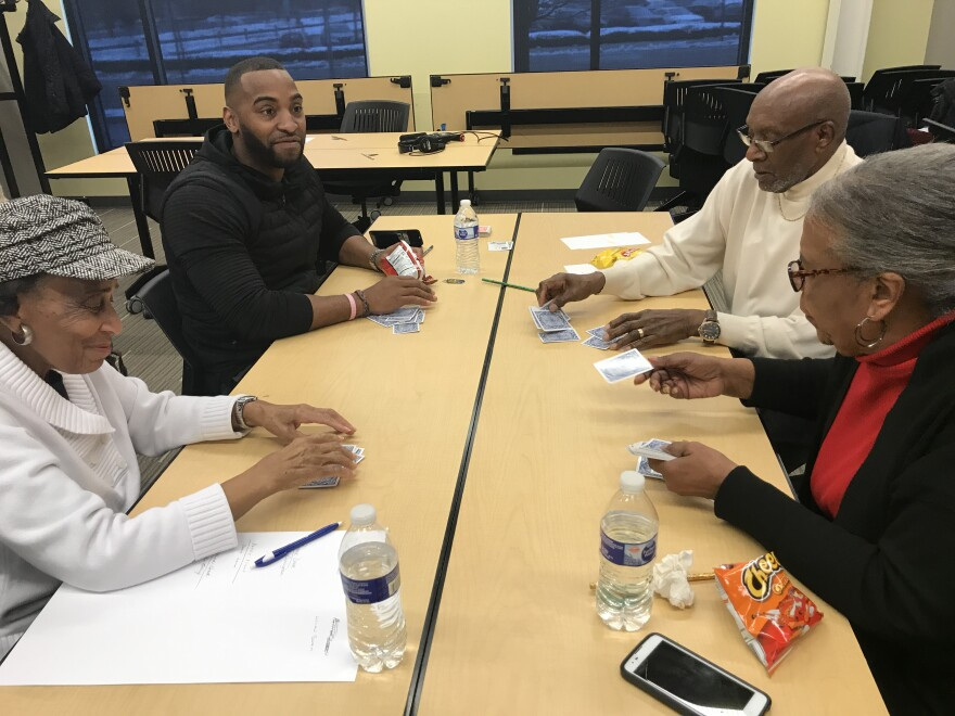 Raphael Allen, Alexander McCarty, Lillian Swain and Virginia McCarty (clockwise from top left) play a game of bid whist at Clark State Community College.