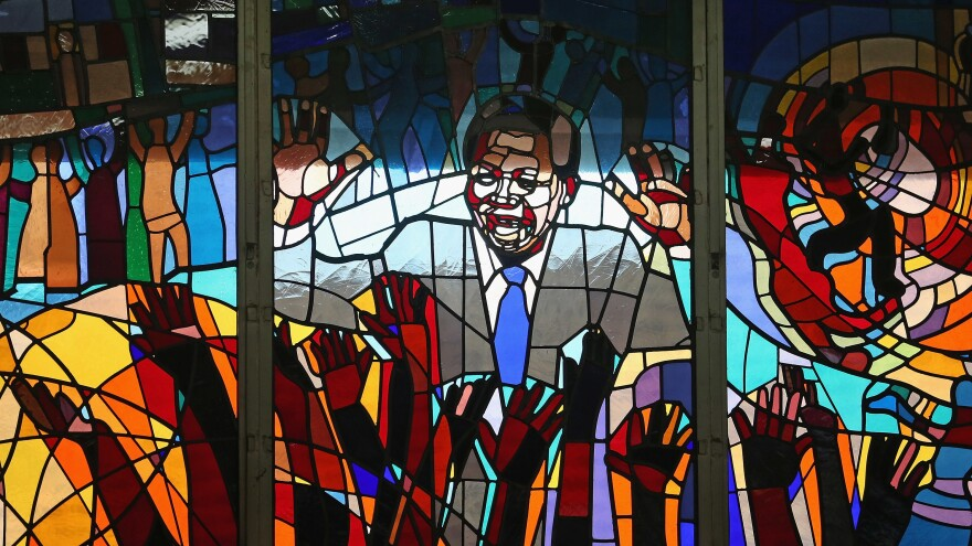 Former South African President Nelson Mandela is depicted in a stained glass at Regina Mundi Catholic Church in Soweto, South Africa.