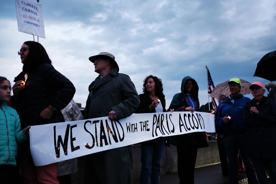 Dozens of Connecticut residents converge along a bridge at a vigil and rally for the environment and against President Trump's recent decision to withdraw the United States from the Paris climate accord on June 4, 2017 in Westport, Connecticut. (Spencer Platt/Getty Images)
