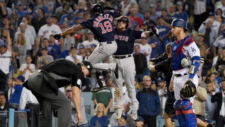 """""""You can go up on a steep hill in Las Vegas and look West, and with the right kind of eyes you can almost see the high-water mark."""" Jackie Bradley Jr. of the Boston Red Sox is congratulated by teammate Christian Vazquez on Friday after his eighth inning home run against the Los Angeles Dodgers in Game 3 of the 2018 World Series. The homer tied the game and ultimately sent it into extra innings."""