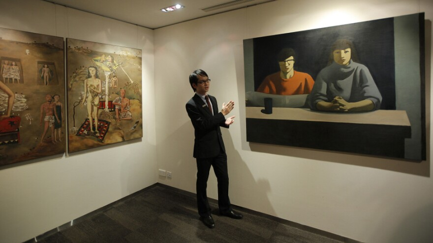 <p>These two paintings were up for auction in Hong Kong in February. Art auctions produce eye-popping sales figures in China, though critics say there is a widespread problem with fakes. </p>