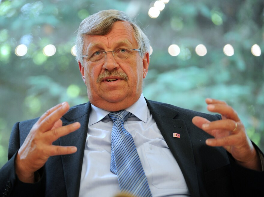 Walter Lübcke<em>, </em>shown here in 2012, was a staunch supporter of Chancellor Angela Merkel's open-door refugee policy.