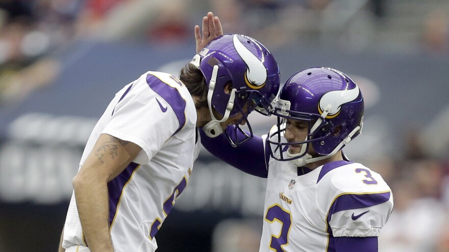 Chris Kluwe (left) congratulates Blair Walsh after Walsh kicked a 56-yard field goal during a game against the Houston Texans in 2012. Kluwe says friendships in the NFL can be fleeting, but also close.