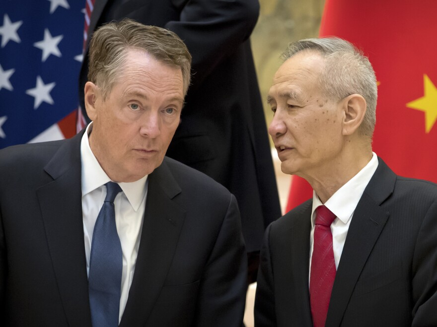 U.S. Trade Representative Robert Lighthizer, left, listens to Chinese Vice Premier Liu He at the Diaoyutai State Guesthouse in Beijing last week. The two will meet tomorrow as negotiations continue.