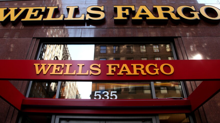 The Fed restricted Wells Fargo's growth and called for the replacement of four board members following a widespread scandal that saw millions of fake accounts opened.