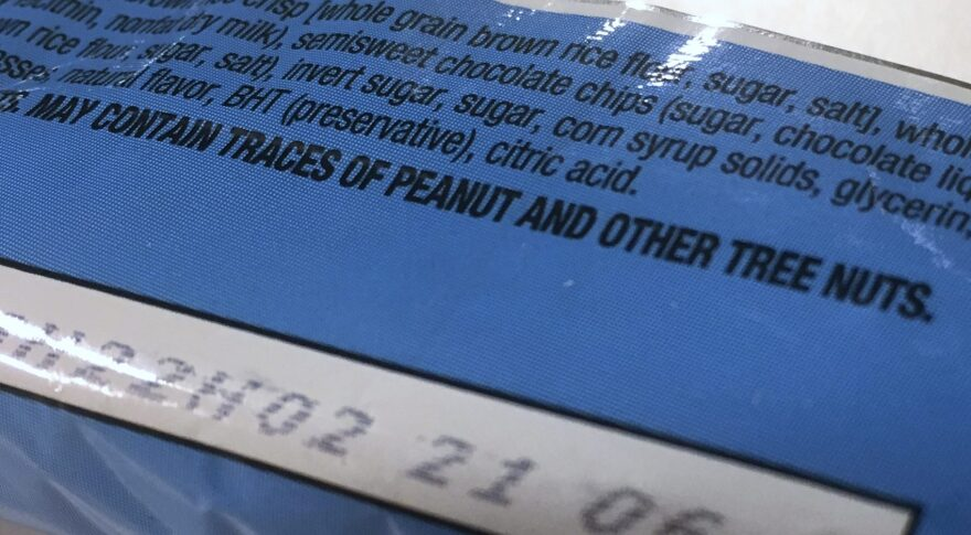 """This Nov. 30, 2016, photo shows part of a food label that states the product """"may contain traces of peanut and other tree nuts"""" as photographed in Washington. (Jon Elswick/AP)"""