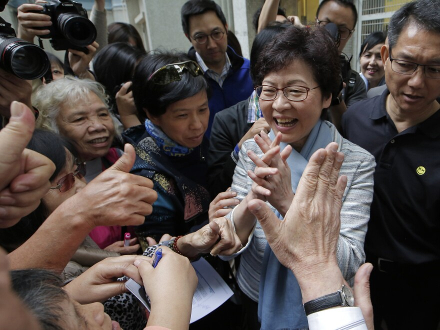 Carrie Lam, a candidate for Hong Kong's chief executive, greets supporters on Thursday. She is considered Beijing's preferred candidate and is widely expected to win Sunday's vote.