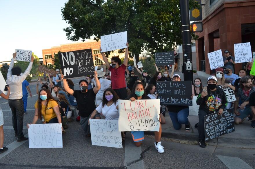 Protestors hold sign at a Black Lives Matter event in St. George, Utah.