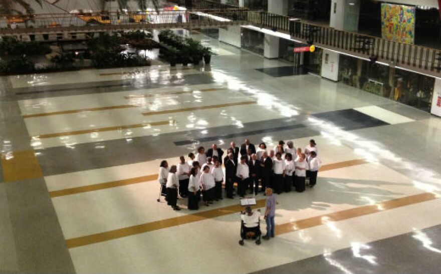 The South Dallas Concert Choir sang the final lines that Kennedy was to deliver -- they sang on the floor of the Dallas Trade Mart, where Kennedy was to speak.