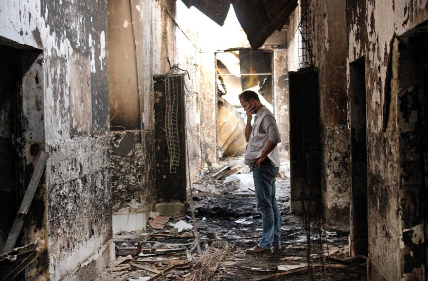 An employee of Doctors Without Borders walks inside the charred remains of the organization's hospital after it was hit by a U.S. airstrike in Kunduz, Afghanistan in October.