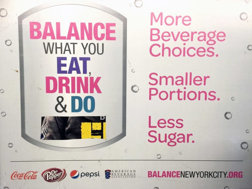 A billboard at a New York subway stop in Brooklyn nudges consumers to think about the calories they consume. It's part of a soda industry-funded campaign to target obesity.