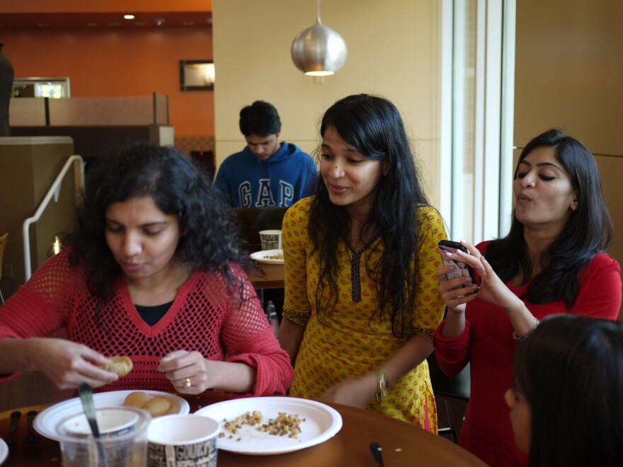 Upasana Kone (center) cheers on some Microsoft employees at an Indian street food competition to raise money for Child Rights and You, a nonprofit that conducts child development projects in India and the U.S.