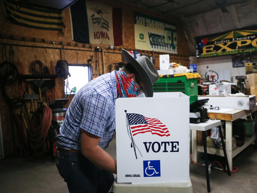 A voter marks his ballot at a polling place in Dennis Wilkening's shed on November 3, 2020 in Richland, Iowa.