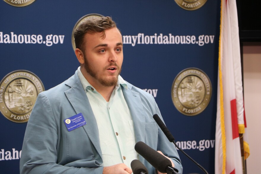 Young man speaks at a podium.