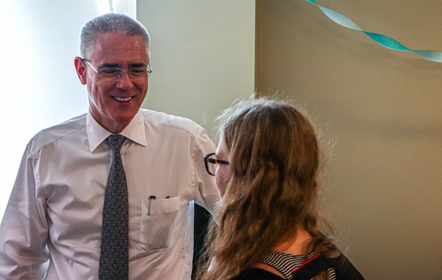 "Steve Currall, president of USF, greeted students after they received their shots for the ""4 U's Fight the Flu"" at the Student Health Services Annex on Wednesday. Thomas Iacobucci/WUSF Public Media"