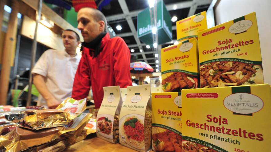 """Fair workers at a vegetarian stand sell meatless items at the """"Bio"""" (organic food) section of the International Green Week Food and Agriculture Fair in Berlin in 2011. Germany's minister of agriculture has called for a ban on using meaty words like """"schnitzel"""" and """"würst"""" to market such products."""