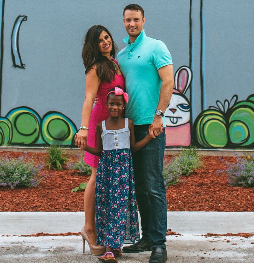 Danielle and Adam Dowd with their daughter, Alice.