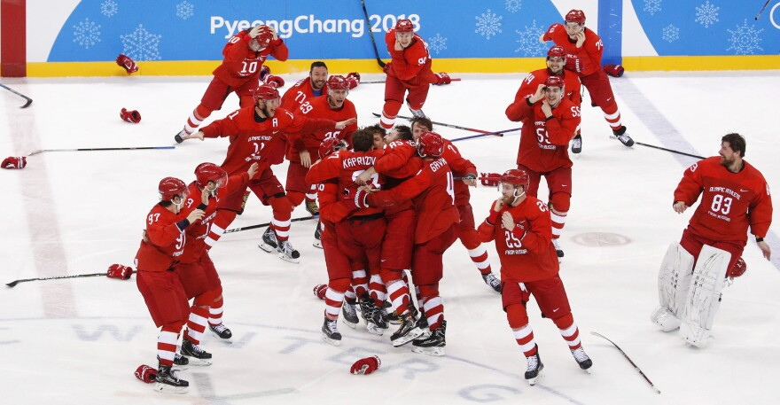 Russian athletes celebrate after winning the men's gold medal hockey game against Germany, 4-3, in overtime Feb. 25. It was the second gold for the Olympic Athletes from Russia.