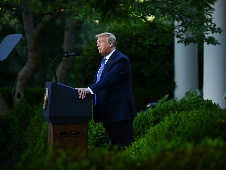 President Trump delivers remarks in front of the media in the Rose Garden of the White House on Monday.