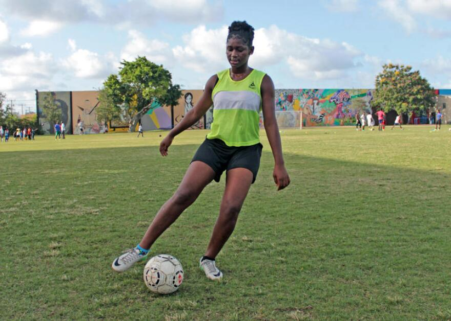 Wadeline Saintjuste dribbles a soccer ball during team practice at Little Haiti Soccer Park in Miami on July 27, 2016.