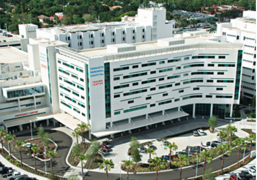 An aerial shot of white building which is Sarasota Memorial Hospital