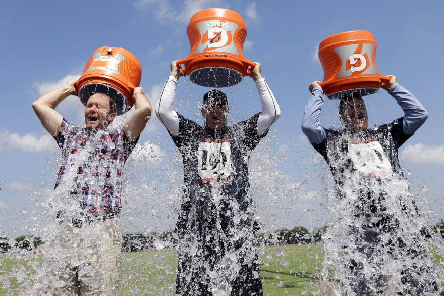 Houston Texans Coach Bill O'Brien (center) Chief Operating Officer Cal McNair (right) and <em>Houston Chronicle </em>reporter Brian Smith take the ALS Ice Bucket Challenge Thursday to raise money for the ALS Association.