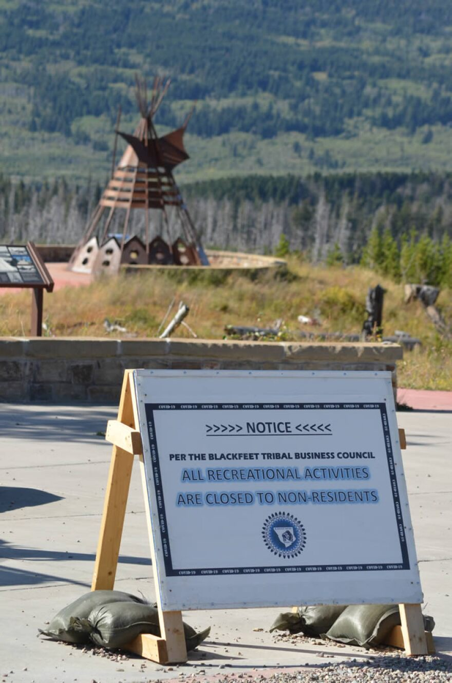 Signs warning about activity restrictions on the Blackfeet Indian Reservation due to the COVID-19 pandemic stand on all roadway entrances to the reservation, September 2020.