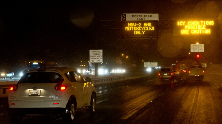Signs warn drivers of icy road conditions on Interstate 66 in Fairfax County, Va., in March 2014. The state's Department of Transportation recently added rush hour tolls to the road, using dynamic pricing, which continuously adjusts the cost based on congestion.