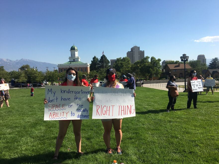 Photo of two teachers at a rally.