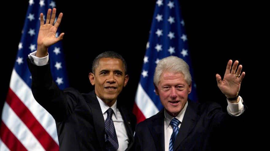 President Obama and former President Bill Clinton appear at a  campaign event in New York in June.